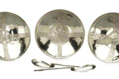 Silver bowls and spoons.